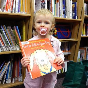 Toddler girl with picture book