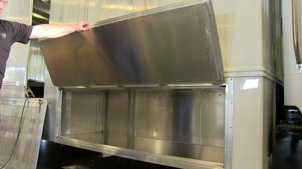 Bookmobile storage compartment