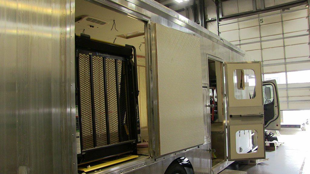 Side door opens to reveal wheelchair ramp