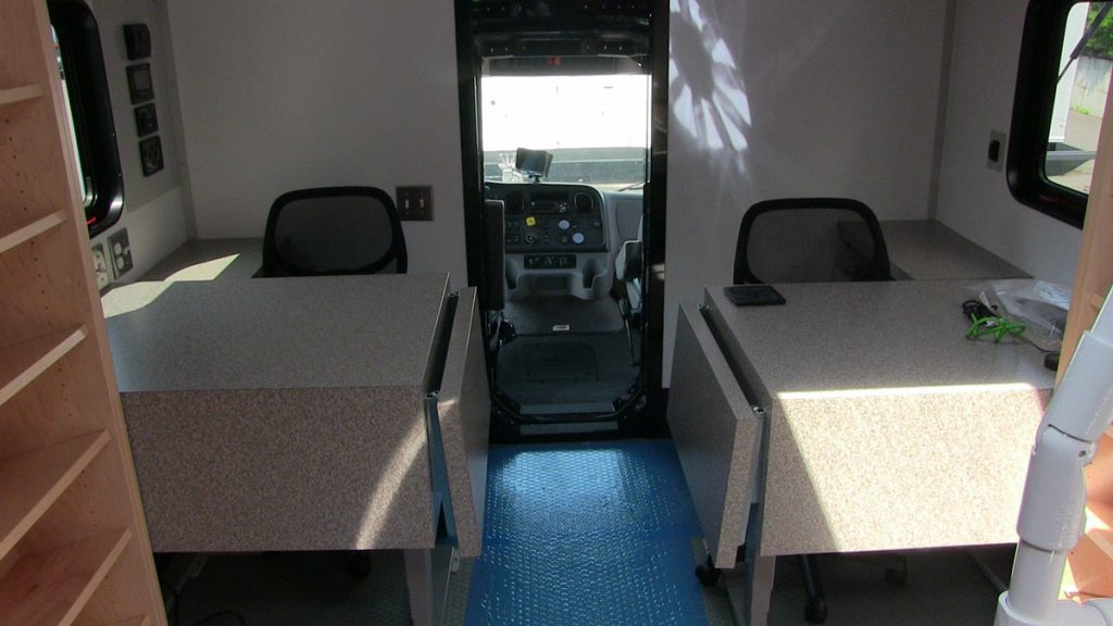 Bookmobile inside front with tables and chairs