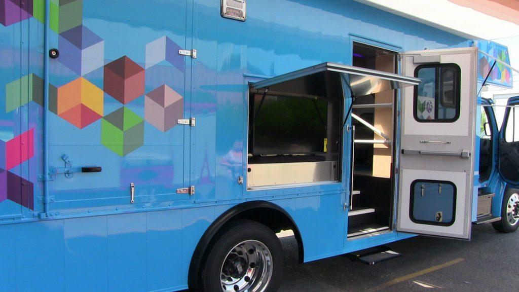 Bookmobile exterior television monitor