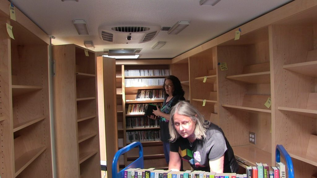Moving books to the new bookmobile.