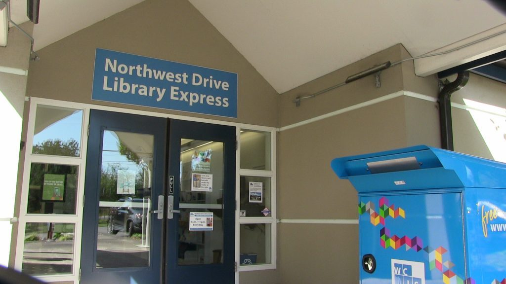 Photo of Library Express doorway at 5205 Northwest Drive