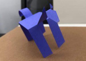 image of walking paper horse