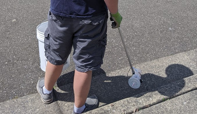 Close up photo of person picking up litter