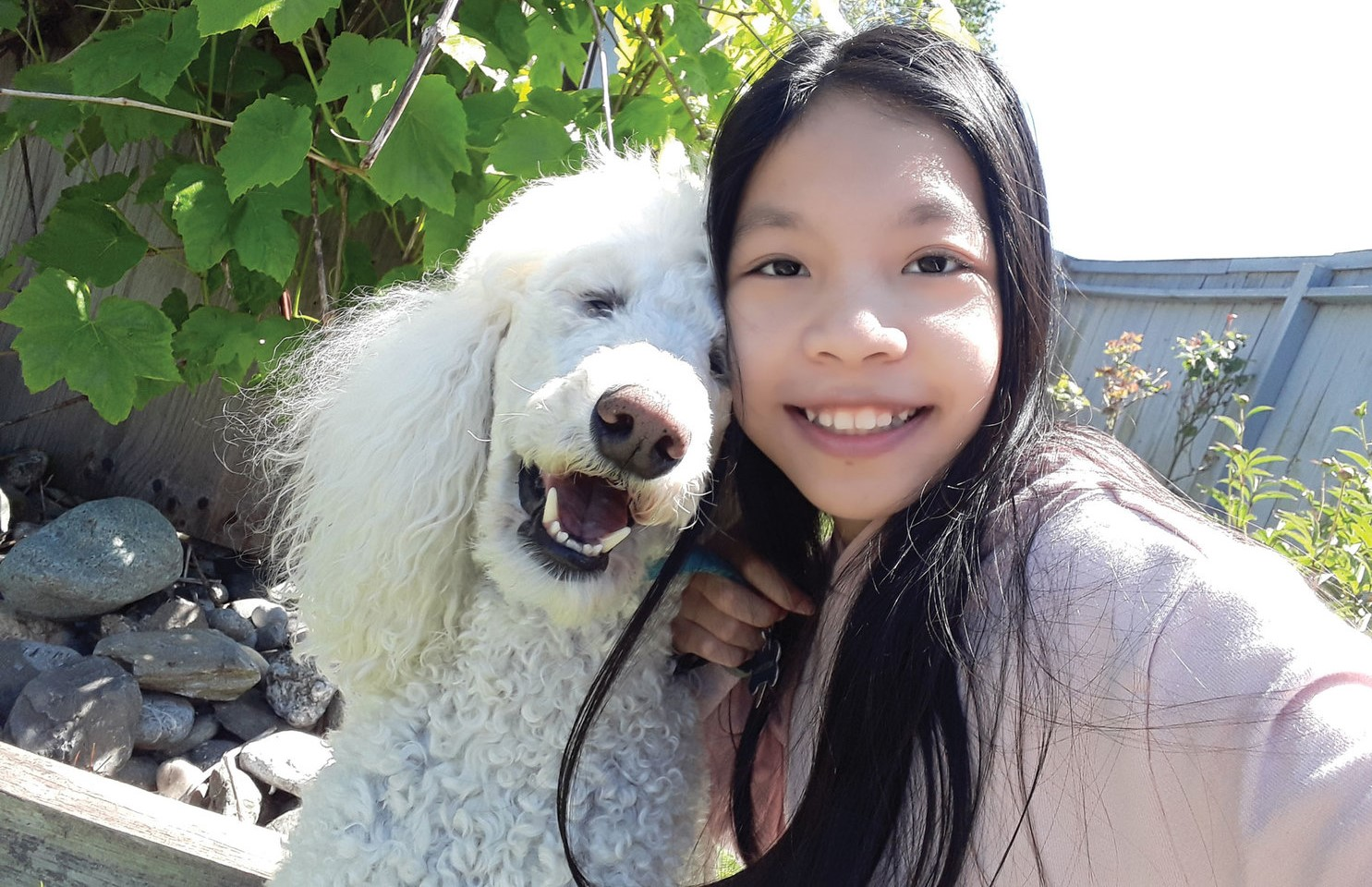 Photo of girl and dog