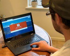 Image of man using laptop