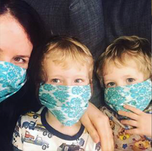 photo of Sharon Shewmake and two sons wearing facemasks