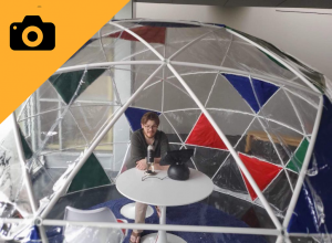 Image of man talking into microphone under geodesic dome